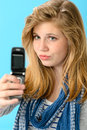 Young girl taking picture of herself with mobile phone Stock Images