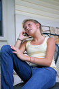 Young Girl talking on cell phone Royalty Free Stock Photography