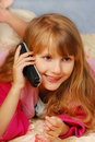 Young girl talking by phone Stock Photo