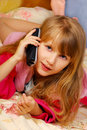 Young girl talking by phone Stock Image