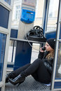 The young girl in telephone booth Royalty Free Stock Photography