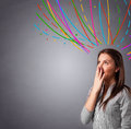 Young girl thinking with colorful abstract lines overhead Royalty Free Stock Photo
