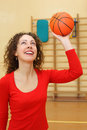 Young girl throws basketball ball Royalty Free Stock Images