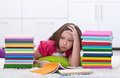 Young girl tired learning Stock Image
