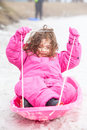 Young girl tobogganing a at lake mountain in victoria australia Royalty Free Stock Photo