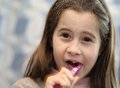 Young girl without a tooth while brushing teeth pretty in the bathroom Stock Photography