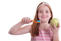 Young girl with toothbrush and fresh green apple beutiful healthy life concept studio shon on white Royalty Free Stock Images