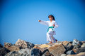 Young girl training karate against the sky Royalty Free Stock Image