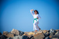 Young girl training karate against the sky Royalty Free Stock Photo