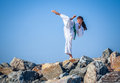 Young girl training karate against the sky Stock Photos