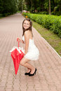 Young girl with umbrella in park Royalty Free Stock Photography