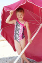 Young Girl Under Beach Umbrella Royalty Free Stock Photography
