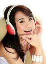Young girl use headphones portrait listening music used and looking at camera Royalty Free Stock Image