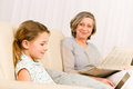 Young girl using laptop grandmother relax Stock Photos