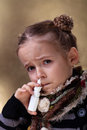 Young girl using nasal spray looking worried Stock Photos