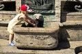 Young girl and water fountain cute washing her hands under old stone Stock Photos