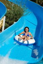 Young girl on water slide Stock Photos