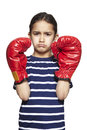 Young girl wearing boxing gloves sad upset white background Stock Photos