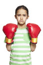 Young girl wearing boxing gloves sad and upset on white background Stock Image