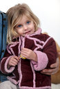 Young girl wearing coat holding lolly Stock Photos