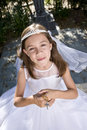 Young girl wearing first communion dress Stock Photo