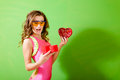 Young girl wearing lycra jumpsuit and protect picture of happy woman pink safety glasses opening red giftbox half length of Stock Photos