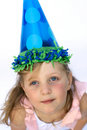 Young girl wearing party hat Royalty Free Stock Photos
