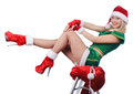 Young girl wearing santa claus clothes and high heels Royalty Free Stock Photo