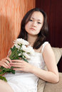 Young girl and white chrysanthemums Royalty Free Stock Images