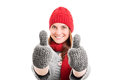 Young girl in winter clothes giving a thumbs up Royalty Free Stock Photo