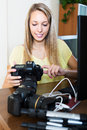 Young girl working with photocamera Royalty Free Stock Photo