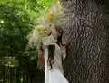 Young girl in wreath walks in forest. Folk style. Royalty Free Stock Photo