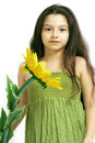 Young girl with yellow flower Stock Photo