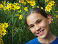 Young girl with yellow flowers a portrait of a in a blue shirt by Stock Photo