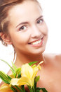 Young girl with yellow lily laughs happy Royalty Free Stock Images