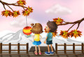 A young girl and a young boy at the bridge illustration of Royalty Free Stock Photos