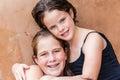 Young Girls Cousins Hugs