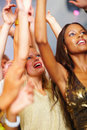 Young girls dancing together at nightclub Royalty Free Stock Photos