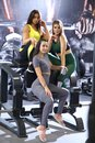Young girls doing fitness exercises in the gym. Training in the gym for body shaping. Royalty Free Stock Photo