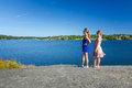 Young girls enjoy the summer sea coast view Royalty Free Stock Photo