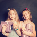Young girls with gift box pink Stock Image