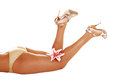 Young girls legs the and butt of a woman in a cold color bikini panty and high heels lying on her stomach for white background in Stock Photo