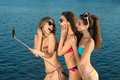 Young girls make selfie at rest on the beach people the resort leisure sea sunbathing on the sea Royalty Free Stock Photos