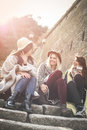 Young girls sitting on the stairs at the public park and h Royalty Free Stock Photo