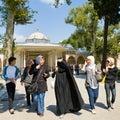 Young girls in Topkapi countryard  in Istanbul Royalty Free Stock Image
