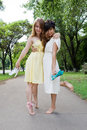 Young girls walking barefoot in the park Royalty Free Stock Image