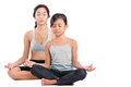 Young girls in yoga girl and a lady meditation position Stock Image