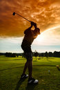 Young golf player on course doing golf swing he presumably does exercise Stock Photo