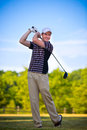 Young Golfer Swing Club Stock Photo