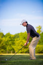 Young Golfer Swing Club under Summer Blue Sky Royalty Free Stock Photo